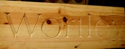 V carved text into Pine